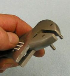 Adjustable Pin Wrench by Ron of Va -- An adaptation of an adjustable wrench to function as pin wrench. The pins are a light press fit into holes drilled through the sides of the wrench's jaws, providing a further adjustment in pin depth. http://www.homemadetools.net/homemade-adjustable-pin-wrench