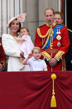 Catherine, Duchess of Cambridge, Princess Charlotte of Cambridge, Prince George of Cambridge and Prince William, Duke of Cambridge watch a fly past during the Trooping the Colour, this year marking the Queen's 90th birthday at The Mall on June 11, 2016 in London