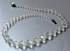 Faceted Crystal Bead Necklace 1950's Choker . This necklace has clear graduated crystal beads and closes with a sliding clasp. Very versatile and can be worn with anything ... #vintage #ecochic #jewelry