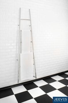 Jeeves Tangent L heated ladder rail in mirror-polished stainless steel. #jeevesheatedtowelrails #heatedtowelrails #bathroomdesign #towelwarmers #interiordesign #interior #bathroom #homedecor