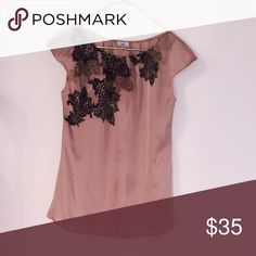 Gold floral silk blouse This silk blouse is in perfect condition. Has a black lace floral design and a rouched neckline. Has a button on the back to help get into Worthington Tops Blouses