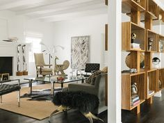 Need room divider ideas for the living room, bedroom, or kitchen? We've rounded up 4 of the chicest ways to divide a room, from screens to bookshelves! Narrow Living Room, Chic Living Room, Living Spaces, Living Rooms, Room Divider Curtain, Room Dividers, Creating An Entryway, Chic Office Decor, Open Bookcase