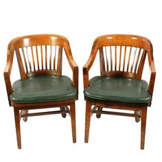 Pair of Gunlocke Chair Co. Arm Chairs A pair of early 20th century American Gunlocke Chair Company desk arm chairs. The chairs are extremely heavy quality and well made with maker's labels underneath. The chairs have a multi-slatted back and a shaped seat with a leather covered pad. The legs are joined by cross rails adding to their strength, we think the timber used is stained beech wood. The chairs are well made and comfortable to sit in and have the original manufacturer's labels under Arm Chairs, Dining Chairs, Antique Armchairs, Antique Restoration, Selling Antiques, Occasional Chairs, Leather Cover, Furniture Design, Arms