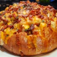 This recipe from Savory Recipes is so good -this is like the one Rachael Ray made recently. This is made with sourdough bread, sliced in a checkerboard fashion- almost to the bottom, but left in-tack; then covered with crispy Bacon pieces and cheese, then drenched in ranch flavored butter. This appetizer is bound to  make everyone ask for the recipe!So have plenty of copies on hand,lol.  Photo from Savory Recipes.
