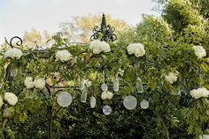 Hanging Decorations on Arbor for Outdoor Wedding Ceremony