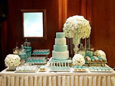 TIFFANY & CO.: For their exclusive Bridal Event in September 2012, I created a four-tier wedding cake in their signature Tiffany blue with intricate piping in royal icing. The dessert table was fabulous - well done Chern Ling!