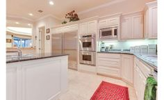 Love this kitchen! Double ovens and a huge fridge too!