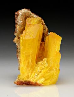 Legrandite Zn2(AsO4)(OH)·(H2O) - Ojuela Mine, Mapimi, Mun. de Mapimi, Durango, Mexico Size: 3.0 x 1.8 x 1.5 cm (thumbnail)  ex.  Ron Pellar collection. -  Fine yellow terminated crystals of legrandite set in a small vug in a 3.0 x 1.8 x 1.5 cm matrix. The crystals are slightly translucent & the piece is free of damage.  Ron Pellar collection.
