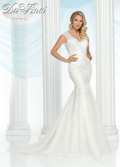 DaVinci Bridal Style # 50413 This gorgeous gown is draped in lace covering the v-neckline and sheer sleeves.  The trumpet skirt has cascading lace extending into a chapel length train.