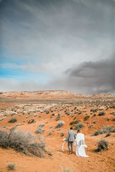 Adventurous couple walks hand in hand through the desert. A storm looms on the horizon. Joshua Tree Wedding, Epic Photos, Park Weddings, Best Photographers, Monument Valley, National Parks, Elopements, Adventure