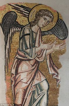 Restoration experts have uncovered an eight-foot-tall mosaic angel at the 'birthplace of J...