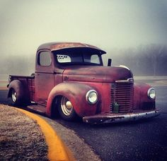 rat rod jalopy daily driver International Harvester IH pickup truck slammed over chrome steel wheels and sporting a fixed windshield visor.