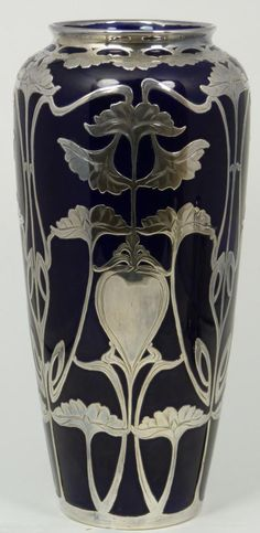 "ART NOUVEAU COBALT PORCELAIN VASE w SILVER OVERLAY  Antique cobalt blue porcelain vase with silver overlay. Beautiful Art Nouveau floral sterling silver overlay design throughout. No monogram or removal. 19th century. Measures 10 3/8"" height (26.3cm)."