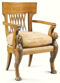 A carved mahogany armchair in the manner of Jacob Frères Rue Meslée  Empire, circa 1810 with a curved back above pierced splat with diapers above a loose cushion leather seat on winged lioness monopodia carved with stylised scallopshell and an anthemion supports and sabre back legs; leather cushion distressed