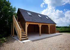 Discover how we created a bespoke three bay timber garage with an additional storage room above.