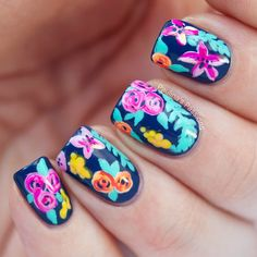 Beautiful blue nails covered in floral design