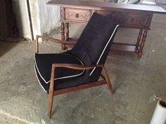 danish chair made in fabric and walnut wood, $1,700