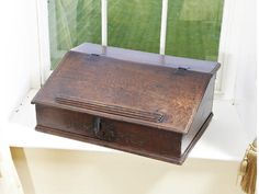 A LATE 17TH CENTURY JOINED AND BOARDED OAK DESK BOX, CARVED WITH THE DATE '1685' [OR 1683?] Sold for £525 (US$ 883) inc. premium
