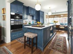 The newly renovated kitchen in TOH's Charlestown Project House features an efficient layout with work areas and appliances in convenient proximity. Custom cabinets by Plain&Fancy, stained in a deep blue, have the appealing look of old painted furniture. | Photo: Anthony Tieuli