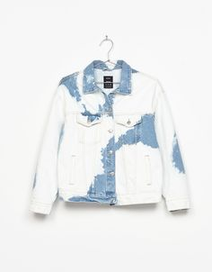 Denim jacket with bleach stains. Discover this and many more items in Bershka with new products every week