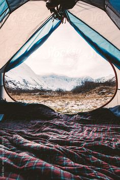 A view from inside a tent after waking up in the mountains in Alaska