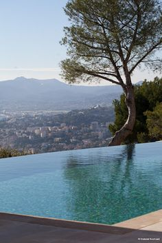 infinity pool frames a gorgeous hillside view