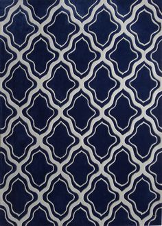 This hand crafted navy blue indoor area rug,has a nice mellow tone to it's touch.But yet it'll stand out soon as you roll it out.  http://rugaddiction.com/collections/saturn/products/indoor-navy-blue-hand-tufted-contemporary-area-rug