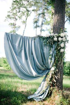 Dusty Blue Wedding Color Ideas for 2020 Dusty blue and greenery wedding backdrop Wedding Ceremony Arch, Ceremony Backdrop, Outdoor Ceremony, Wedding Vows, Wedding Arches, 2017 Wedding, Fabric Backdrop Wedding, Wedding Flowers, Camp Wedding