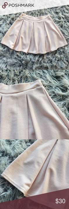 Pastel colored plated mini skirt New, never worn. Pastel colored pleated mini skirt, size us 4. Thank you for visiting my closet, please let me know if you have any questions. I offer great discounts on bundles :) Boohoo Skirts Mini