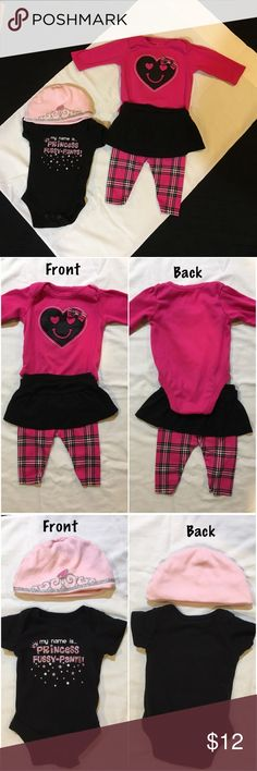 2 Garanimals out fits with hat Front left to right: princes hat with black onesie that says my name is... princess fussy pants and has pink and white stars, pink long sleeve onesie with pink smiling heart and bow and plaid pants with attached black skirt. Gently used. Don't forget to bundle! Garanimals Matching Sets
