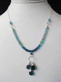 Apatite and Blue Topaz Necklace.  Sterling Silver wrapped Topaz briolettes surrounded with different shades of Blue Apatite. www.sarahwalkerjewelry.com