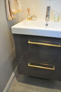 IKEA Godmorgon vanity in high gloss grey.
