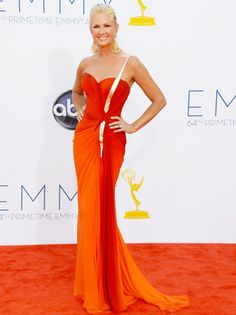 Entertainment Tonight host Nancy O'Dell's fiery frock blends into the carpet.