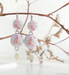 Soft Blue Earrings Hand Decorated with Pastel Pink Flowers Made of Polymer clay by Embroidery Technique. Decorated with Quartz stones.