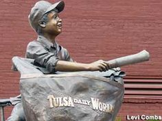 Tulsa, Oklahoma: Newspaper Boy Statue - Bronze statue of the quintessential 20th century newspaper boy,  cheerily delivering a copy of the Tulsa Daily World from his bicycle