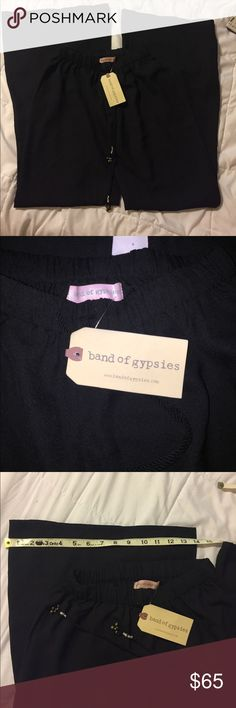 Band of gypsies wide leg pant Black, %100 poly, flowy. Elastic waist with tassel drawstring. Very long for an XS inseam 34. Band of Gypsies Pants Wide Leg