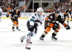 San Jose Sharks forward Jeremy Langlois skates past Hampus Lindholm of the Anaheim Ducks during the first period (Oct. 3, 2015).