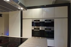 A modern streamlined kitchen with ample storage and built in ovens by Miele. Designed and installed by Stuart Frazer.