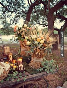 wheat stacks with fresh cut flowers, beautiful and unique for both isle deco and table centerpieces.