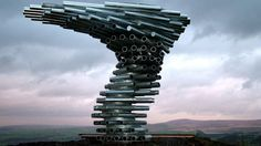 Singing Ringing Tree is a wind powered sound sculpture resembling a tree set in the landscape of the Pennine hill range overlooking Burnley, in Lancashire, England