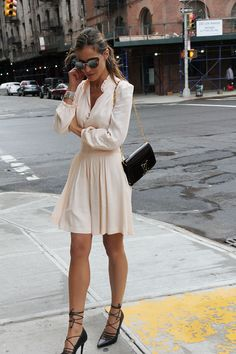 "justthedesign: "" This cute cream dress looks simple but effective with strappy black heels and a YSL bag. Via Silvia Zamora. Dress: Maje, Shoes: Aldo. """