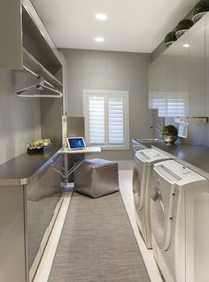 Love the hanging idea in this photo. Sleek contemporary laundry room...