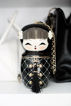 """This Closet Is Bigger Than Your Entire New York Apartment #refinery29  http://www.refinery29.com/lori-hirshleifer-home-tour#slide-3  Matryoshka madness! The ultimate street-style staple: a Chanel """"China Doll"""" bag."""