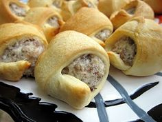 Sausage & Cream Cheese Crescents 16 oz sausage cooked and crumbled 8 oz cream cheese softened 2 cans of crescent rolls  Mix sausage and cream cheese together. Separate rolls into triangles. Cut each triangle in half lengthwise. Scoop a heaping tablespoon onto each crescent and roll up. Bake at 375 for 15 minutes, or until golden brown.