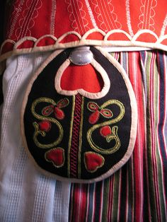 "Detail of traditional dress apron, skirt, vest and pocket (hooked onto skirt waist with silver clasp) from ""folkdräkt"" of Östra Härad,Småland, Sweden. Swedish Style, Swedish Design, Sweden Costume, Scandinavian Folk Art, Scandinavian Embroidery, Swedish Embroidery, Folk Costume, Costumes, Folk Fashion"