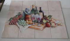Wine Time - RB - Tile Mural Digitally reproduced for tiles and depicts wine bottles, wine glasses, cheese, grapes and fruit Our decorative tiles with wine are perfect to use for your kitchen splashback tile project. A wine tile mural adds elegance and interest to your kitchen wall tile area and makes a wonderful kitchen splash back idea. Pictures of wine on tiles and images of wines bottles on tiles and wine glasses on tiles is timeless and these decorative tiles of wine blend with any…