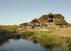 Surrounded by African bush Tutwa Desert Lodge offers accommodations in the Greater Augrabies area between the Green Kalahari and the Orange River. Tutwa Desert Lodge Augrabies South Africa R:Northern Cape hotel Hotels Oasis, South Africa, Deserts, Romantic, Mansions, House Styles, Travel, Home Decor, Boutique Hotels