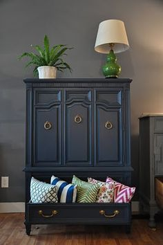 Such a great idea... leave a bottom drawer empty for all the throw pillows so they just don't get thrown all over the place.