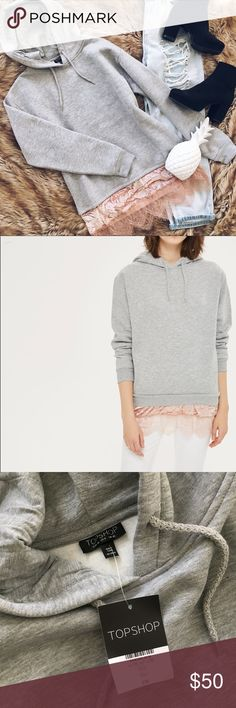 Topshop gray hoodie with pink velvet lace hem A brand new never before worn with tags attached hoodie from top shop. Marled gray in color with a light pink crushed velvet and lace hem. Crew neck. Long sleeves. Attached hood with drawstrings. Velvet and lace trim scalloped hem. Knit construction. Fleece lining. Size 6. Please ask if you need measurements! Topshop Tops Sweatshirts & Hoodies