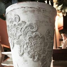 Decorate your planters with doilies and lace for a pretty and rustic look in your garden!